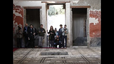Journalists take photos in the Casa di Paquius Proculus.