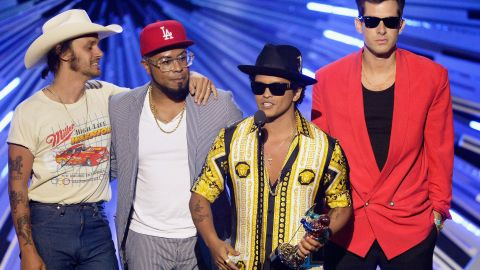 Bruno Mars, third from left, who has had numerous No. 1 singles on different chats, is estimated to be worth north of $70 million.