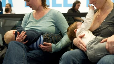 """Women breastfeed their babies at the Hirshhorn Museum in Washington on February 12, 2011 during a """"nurse-in""""organized after a woman was stopped from nursing in public at the museum by security guards two weeks ago."""