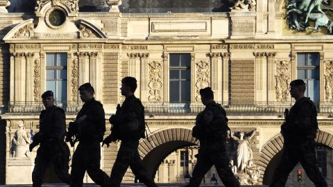 French soldiers patrol next to the Louvre in Paris on December 23, 2015 as part of security measures set following the November 13 Paris terror attacks. / AFP / DOMINIQUE FAGET        (Photo credit should read DOMINIQUE FAGET/AFP/Getty Images)