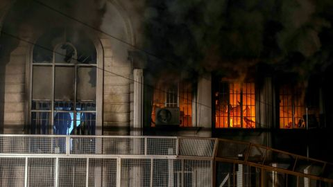 Smoke billows from the windows of the burning Saudi Embassy on January 2. A CNN producer in Tehran said some protesters made it inside the building, setting fire and ransacking some records.