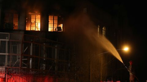 A firefighter sprays water on the flames on January 2 in Tehran, Iran, a Shiite-majority nation, issued a statement deploring the execution and warning that Saudi Arabia would pay a heavy price for its policies.