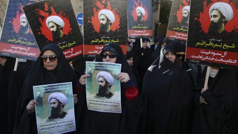Iranian demonstrators hold posters of Sheikh Nimr al-Nimr, a prominent opposition Saudi Shiite cleric, during a protest denouncing his execution, in front of the Saudi Embassy, in Tehran, Sunday, Jan. 3, 2016. Saudi Arabia announced the execution of al-Nimr on Saturday along with 46 others. Al-Nimr was a central figure in protests by Saudi Arabia's Shiite minority until his arrest in 2012, and his execution drew condemnation from Shiites across the region. (AP Photo/Vahid Salemi)
