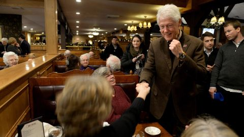 Former U.S. President Bill Clinton greets diners at the Puritan Backroom January 4, 2016 in Manchester, New Hampshire.