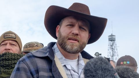 Ammon Bundy(R), leader of a group of armed anti-government protesters speaks to the media as other members look on at the Malheur National Wildlife Refuge near Burns, Oregon January 4, 2016.