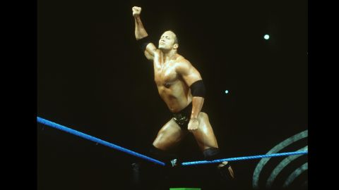 """Johnson followed in the footsteps of his father, Rocky, and maternal grandfather, Peter Maivia, by becoming a professional wrestler in the late '90s. Holder of more than a dozen titles, the hugely popular Rock had only one question: """"Can you smell what The Rock is cooking?"""""""