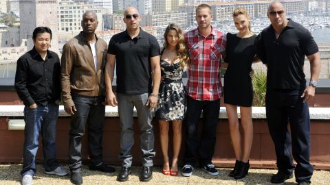"""Johnson helped revitalize """"The Fast and the Furious"""" franchise in 2011's """"Fast Five."""" From left are director Justin Lin and co-stars Tyrese Gibson, Vin Diesel, Elsa Pataky, Paul Walker, Gal Gadot and Johnson."""