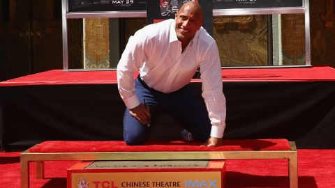 """Johnson's hand- and footprints were immortalized in concrete outside the TCL Chinese Theatre in Hollywood in the leadup to his summer 2015 disaster movie, """"San Andreas."""" He thanked idol Steven Spielberg and signed the concrete, """"Blessed!"""""""