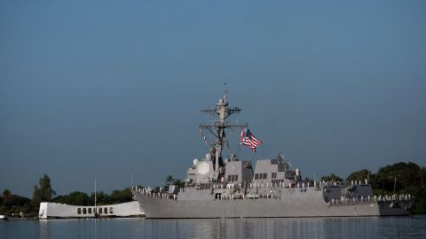 The USS Chafee does a Pass-in-review of the Arizona Memorial in 2010, on the 69th anniversary of the attack on Pearl Harbor.