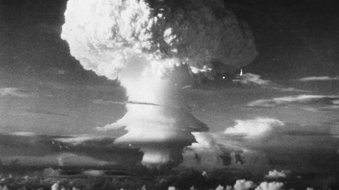 6th November 1952:  Characteristic mushroom shaped cloud begins formation after the first H-Bomb explosion (US) at Eniwetok Atoll in the Pacific.  (Photo by Three Lions/Getty Images)