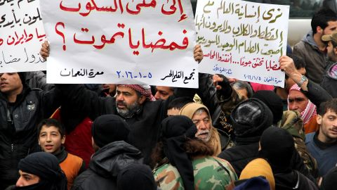 IDLIB, SYRIA - JANUARY 5: Demonstrators hold banners during a protest for civilians who starved to death in Madaya, on January 5, 2016 at Maret el Numan district of Idlib, Syria. (Photo by Firas Faham/Anadolu Agency/Getty Images)