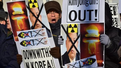 """South Korean conservative activists shout slogans with placards showing portraits of North Korean leader Kim Jong-Un during a rally denouncing North Korea's hydrogen bomb test, in Seoul on January 7, 2016. The US and South Korean presidents vowed on January 7 to impose the """"most powerful and comprehensive"""" sanctions on North Korea after its globally condemned fourth nuclear test. AFP PHOTO / JUNG YEON-JE / AFP / JUNG YEON-JE        (Photo credit should read JUNG YEON-JE/AFP/Getty Images)"""