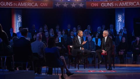 """U.S. President Barack Obama speaks about guns at a town-hall meeting in Fairfax, Virginia, on Thursday, January 7. During the event, moderated by CNN's Anderson Cooper, Obama rejected the """"imaginary fiction"""" that he wanted to take away the guns of law-abiding Americans. He said his opponents had twisted his plans on gun safety measures."""