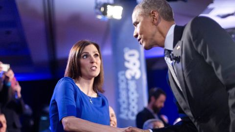 """Obama walks over to greet Taya Kyle, widow of """"American Sniper"""" Chris Kyle, during a commercial break. Earlier in the meeting, she told Obama that background checks give """"almost a false sense of hope"""" and wouldn't have stopped many of the mass shootings we've witnessed. She also noted murder rates are down and maybe we should """"celebrate where we are."""" After thanking Kyle for her husband's service, Obama agreed that crime was down overall, but said, """"I challenge the notion that the reason for that is more gun ownership."""" He compared what he's trying to do to government efforts to make cars safer. """"In the same way that we don't eliminate all traffic accidents but over the course of 20 years, traffic accidents get lower ... that's the same thing that we can do with gun ownership,"""" Obama said."""