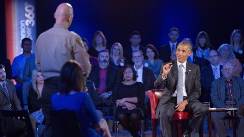 """Obama answers a question from Paul Babeu, a sheriff in Arizona running for Congress. Babeu asked Obama what he's doing to prevent mass shootings, not target guns. Obama criticized the idea that """"if we can't solve every crime, we shouldn't try to solve any crimes,"""" which received applause from the audience. """"The problem is in many instances, you don't know ahead of time who is going to be the criminal."""""""