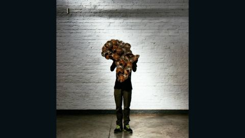 """Pon captures a piece of art by <a href=""""http://simpleintrigue.com/"""" target=""""_blank"""" target=""""_blank"""">Keri Muller</a> called """"Africa Re-Invented"""" in Maboneng, Johannesburg, South Africa."""