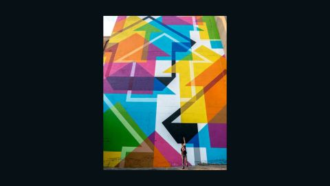 """In Jeppestown, Maboneng Princict, South Africa, Pon catches anonymous artist <a href=""""https://www.instagram.com/abovestudio/?hl=en"""" target=""""_blank"""" target=""""_blank"""">Above</a> as he finishes painting his biggest wall to date."""
