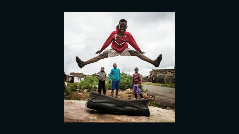 """In Soweto, Gauteng, Pon spots some excited children, posting this image with the caption; """"Stoked. Kids in #Soweto are stoked. Like really stoked."""""""