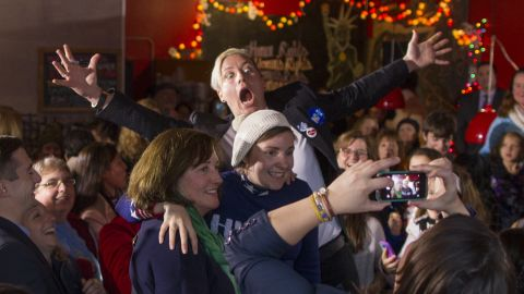 """Around 200 people crowded into a New Hampshire restaurant in January to see retired soccer star Abby Wambach (arms outstretched) and actress Lena Dunham (wearing the hat). Both <a href=""""http://www.cnn.com/2016/01/08/politics/hillary-clinton-lena-dunham-abby-wambach/"""" target=""""_blank"""">endorsed Hillary Clinton.</a> <br /><br />""""I'm embarrassed to say this, but it took me far too long to start voting,"""" Dunham told the crowd. """"I had been of legal age for more than four years before I cast my first vote in the 2008 presidential election. It's not that I didn't care, but I didn't believe that me caring mattered. It was impossible for me to comprehend that one young woman checking a box after waiting in a long line could matter on a national level."""""""