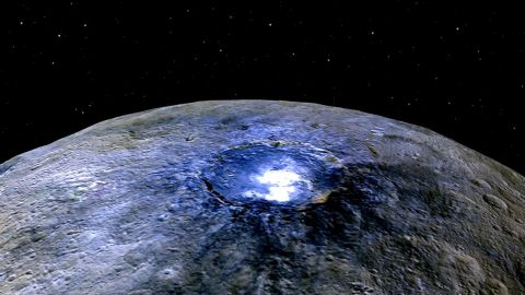 """Ceres has <a href=""""https://www.nasa.gov/feature/jpl/dawn/new-clues-to-ceres-bright-spots-and-origins"""" target=""""_blank"""" target=""""_blank"""">more than 130 bright spots</a>, according to NASA. This false color image shows one of spots -- this one in a crater called Occator. Scientists say the substance appears to be a type of magnesium sulfate called hexahydrite. Scientists use false color to help study differences in surface materials, NASA says."""