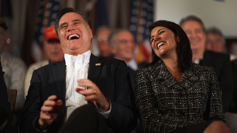 Former Massachusetts Gov. Mitt Romney and Haley laugh during a rally on January 13, 2012, on Hilton Head Island, South Carolina.