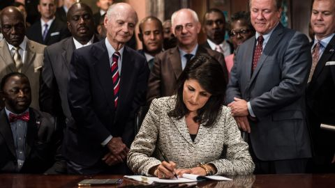 Haley signs a bill on July 9, 2015, to remove the Confederate battle flag from State House grounds.