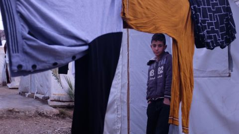 Ayman Salih, 12, pictured at the Esyan refugee camp, had been held in Mosul by ISIS at its training facility.