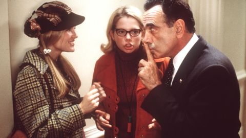 """Dan Hedaya plays Richard Nixon in 1999's """"Dick."""" Two young girls (Kirsten Dunst, left, and Michelle Williams) act as Deep Throat in this parody of the Watergate scandal."""