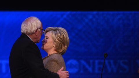 Bernie Sanders and Hillary Clinton leave the stage during a break in the Democratic presidential debate hosted by ABC News at Saint Anselm College in Manchester, New Hampshire, on December 19, 2015.