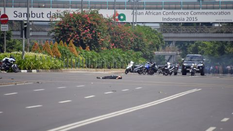 A body lies in the middle of the street near a damaged police post on January 14.