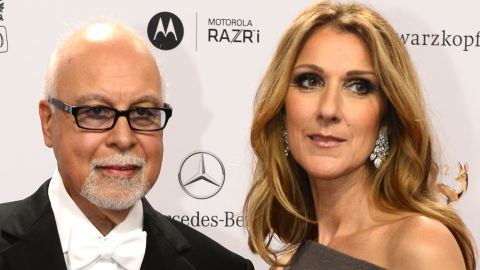 Canadian singer Celine Dion (R) and her husband Rene Angelil pose for photographers as they arrive on the red carpet for the Bambi awards in Duesseldorf, western Germany, on November 22, 2012. The Bambis are the main German media awards. AFP PHOTO / JOHN MACDOUGALL        (Photo credit should read JOHN MACDOUGALL/AFP/Getty Images)