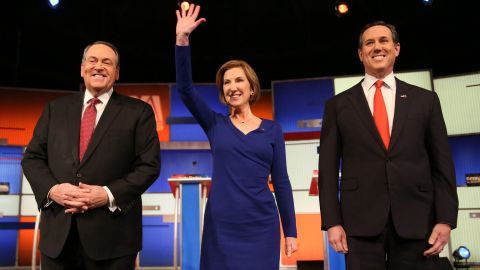 """From left, Republican presidential candidates Mike Huckabee, Carly Fiorina and Rick Santorum arrive for the """"undercard"""" debate that took place a couple of hours before the main event."""
