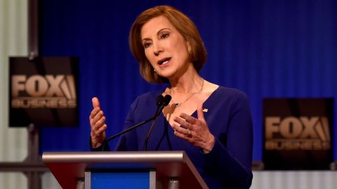 """Fiorina makes a point during the undercard debate. """"The state of our economy is not strong,"""" she said in her opening comments. """"We have record numbers of men out of work. We have record numbers of women living in poverty. We have young people who no longer believe that the American dream applies to them. ... It's time to take our country back."""""""