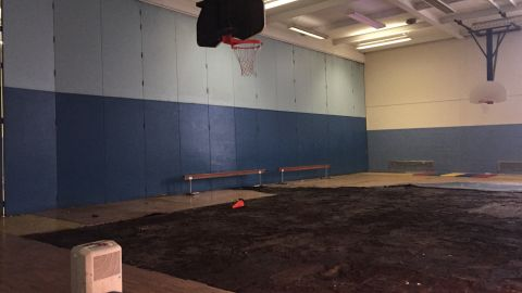 Part of the warped floor was pulled up but not replaced, leaving students without a gym.