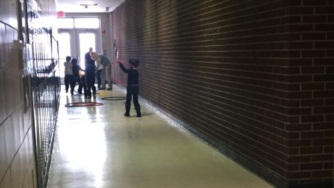Children play in the hallway because the gym and the playground are closed.