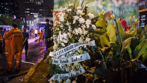 A bouquet of flowers is placed in front of an explosion site on January 14 in Jakarta.
