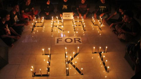 Students light candles to express solidarity for those affected by the deadly attack in Jakarta during a vigil on January 14 in Surabaya, East Java, Indonesia.