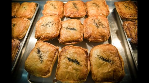 The streetcar stops at Sweet Auburn Curb Market, the city's oldest municipal market, where locals shop from butchers, green grocers and fishmongers. Food stalls offer new and old culinary traditions, from soul food, hamburgers and burritos to arepas, crepes and South African-inspired savory pies, pictured here, from Panbury's Double Crust Pies.