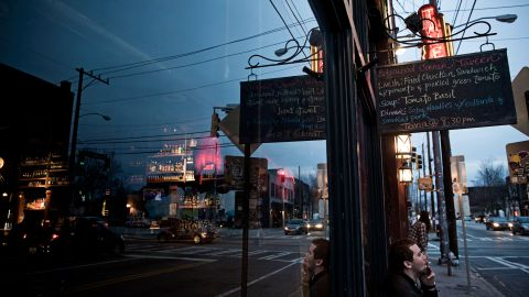 As the sun sets, foot traffic begins to pick up on Edgewood Avenue, one block away from Auburn Avenue. Over the past decade, boarded-up storefronts have transformed into bars and restaurants as more young residents have moved to the inner city.