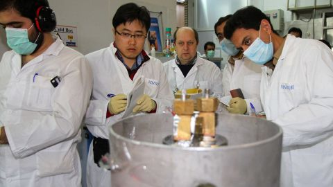 Unidentified International Atomic Energy Agency inspectors and Iranian technicians disconnect the connections between the twin cascades for 20 percent uranium production at nuclear power plant of Natanz on January 20, 2014.