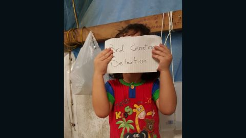 """An image on the Facebook site <a href=""""https://www.facebook.com/Free-the-Children-NAURU-839867502797443/?fref=nf"""" target=""""_blank"""" target=""""_blank"""">""""Free the Children NAURU,""""</a> uploaded in November, 2015, shows a small child with a tally of how long they have been on the island."""