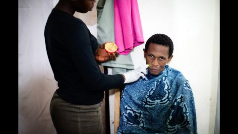 Mama Lususu also has male clients. Hussein, seen here, comes for stain treatment and for bleaching.