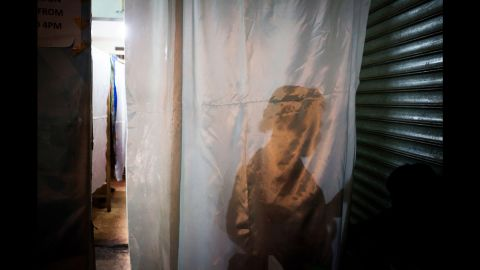 Only a thin plastic curtain separates the waiting area from the treatment cabins in Mama Lususu's salon.