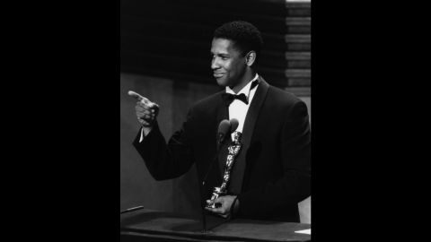"""Denzel Washington accepts his best supporting actor Oscar for the film """"Glory"""" in 1990."""
