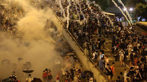 Police fire tear gas at Hong Kong pro-democracy demonstrators.