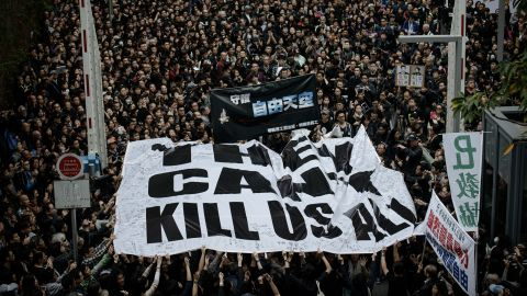 Protesters rally to support press freedom in Hong Kong.