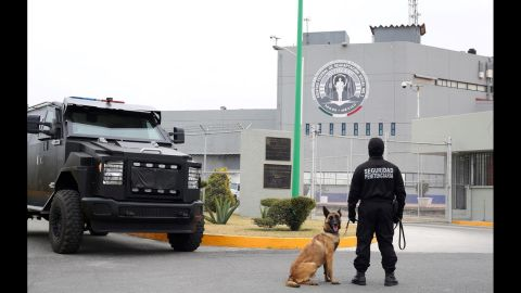 Military vehicles and canine officers guard the Altiplano prison.
