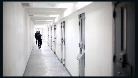 Guards walk down a hallway of the prison, which has installed 400 new cameras. Authorities hope to add another 600 by April.