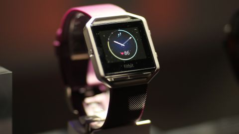 """The new FitBit Blaze is seen at a press conference on CES Press Day, January 5, 2016 in Las Vegas, Nevada ahead of the CES 2016 Consumer Electronics Show. Fitbit on January 5unveiled its """"smart fitness watch,"""" aiming to get into the growing smartwatch segment with upgraded fitness tracking features. The company, which leads the wearable tech market with its wrist-worn trackers but is being challenged by the rise of smartwatches from Apple and others, said its $199 Fitbit Blaze watch was available for pre-order and would be in retail stores globally in May. AFP PHOTO / DAVID MCNEW / AFP / DAVID MCNEW        (Photo credit should read DAVID MCNEW/AFP/Getty Images)"""