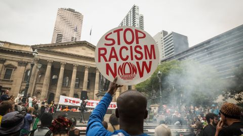 MELBOURNE, AUSTRALIA - NOVEMBER 27:  A man shows his support at the Rally protesting the forced closures of Indigenous communities in Western Australia, at the State Library on November 27, 2015 in Melbourne, Australia.  (Photo by Chris Hopkins/Getty Images)